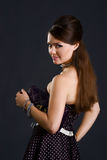 Beautyful girl in retro dress with a handbag Royalty Free Stock Images