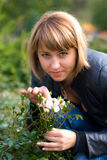 Beautyful girl and roses. Beautiful sexual girl with expressive eyes sniffing beautiful flower - white roses Stock Photos