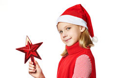 Beautyful girl in Santa hat with red toy star Royalty Free Stock Image