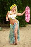 Beautyful hula hawaii dancer girl dancing on beach Stock Photos