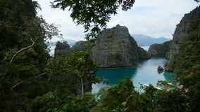 Beautyful lagoon in the islands, Philippines. Kayangan lake or blue lagoon, Coron island, Philippines.View of the cove at Kayangan lake in Coron, Philippines stock footage