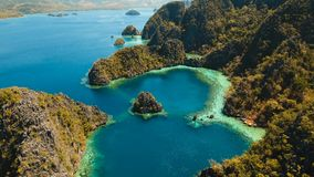 Beautyful lagoon in Kayangan Lake, Philippines, Coron, Palawan. Tropical lagoon with azure water, beach by the Kayangan Lake, Philippines. Aerial view Coron Royalty Free Stock Photography