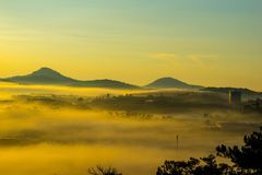 Da lat, lam dong, viet nam- feb 12, 2017: beautyful landscape of da lat city, a small vietnamese pagoda in fog and the pine hill Stock Image