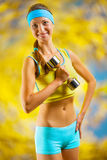 A beautyful sports girl with dumbbell Royalty Free Stock Images