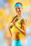 A beautyful sporty girl with dumbbell Royalty Free Stock Photography