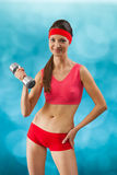 A beautyful sporty girl with dumbbell Stock Images