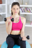 Beautyful sporty girl with dumbbell Royalty Free Stock Photo