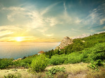 Beautyful sunrise in the sea. Beautyful sunrise in the Black sea and mountains royalty free stock photo