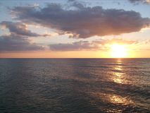 Ocean sunset 006. A really beautyful sunset on the ocean with read and blue sky royalty free stock image