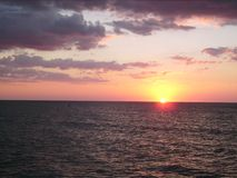 Ocean sunset 009. A really beautyful sunset on the ocean with read and blue sky stock photography