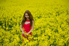 Beautyful teenager model in canola field Royalty Free Stock Photo