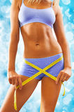 Beautyful woman body with measure tape Royalty Free Stock Photo