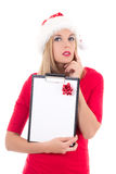 Beautyful woman in santa hat with wish list posing isolated on w Royalty Free Stock Photography