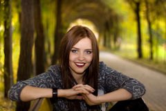 Beautyful woman sitting in park Royalty Free Stock Images