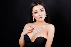 Beautyful young asian woman portrait. jewerly and Royalty Free Stock Images