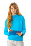 Beautyful young girl writing in clipboard Stock Photography