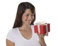 Beautyful young woman with a present Stock Images