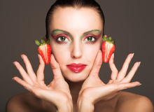 Beautyfull girl with strawberry Stock Photography