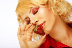 Beautyfull girl with strawberry Royalty Free Stock Photos