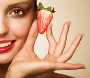 Beautyfull girl with strawberry Royalty Free Stock Images