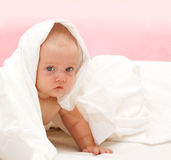 Beautyfull little baby. Cute little baby under the pillow Stock Photos
