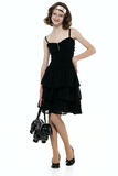 Beautyfull teenage girl in black dress. Beautyfull teenage girl posing in black dress and bag royalty free stock photography