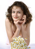 Beautyfull teenage girl - Closeup portrait. Beautyfull teenage girl holding a bouquet of camomiles in a hand - Closeup portrait Stock Image