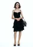 Beautyfull teenage girl posing in black dress. And bag stock images