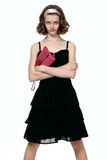 Beautyfull teenage girl posing in black dress. Portrait of young girl on white background stock photo