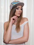 Beautyfull woman wearing hat and vest Stock Photography