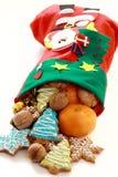 Beaux bas de Noël avec des cadeaux. Photographie stock libre de droits