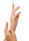 Beaux clous et doigts de femme Photos stock