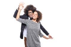 Beaux couples d'amour devant un fond blanc faisant des expressions Image stock