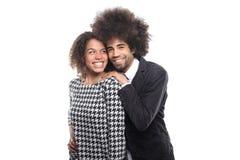Beaux couples d'amour devant un fond blanc faisant des expressions Photographie stock libre de droits