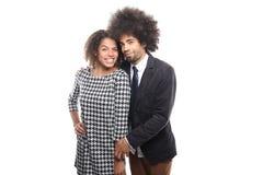 Beaux couples d'amour devant un fond blanc faisant des expressions Photographie stock