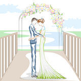 Beaux couples dans la cérémonie de mariage Photos stock