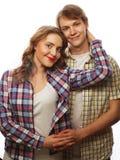 beaux couples heureux étreignant au-dessus du fond blanc Photo stock