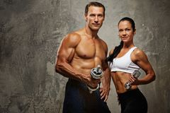 Beaux couples sportifs Photographie stock libre de droits