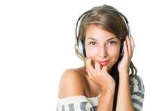 Beaux écouteurs s'usants, d'isolement sur le blanc Photo stock