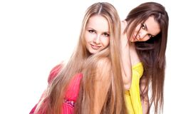 beaux femmes colorés de la robe deux Photographie stock libre de droits