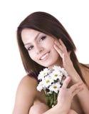 Beaux jeunes avec la fleur. Massage. Photo stock