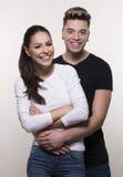Beaux jeunes couples dans le concept d'amour et de combat Photographie stock