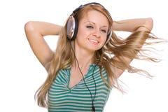 beaux jeunes de femme d'écouteurs Photographie stock