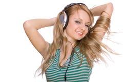 beaux jeunes de femme d'écouteurs Photographie stock libre de droits