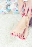 Beaux pieds et mains Image stock