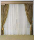 Beaux rideau et glands Photographie stock