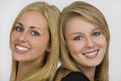 Beaux yeux et sourires Images stock