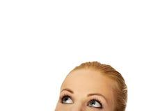 Beaux yeux femelles recherchant pour le copyspace ou quelque chose Photographie stock