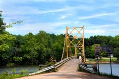 Beaver Bridge. Historic suspension bridge over the White River is a historical landmark.  Located in Beaver, Arkansas just Northwest of Eureka Springs, Arkansas Stock Photography