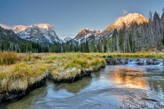 Beaver dam and snow capped mountains Stock Photography